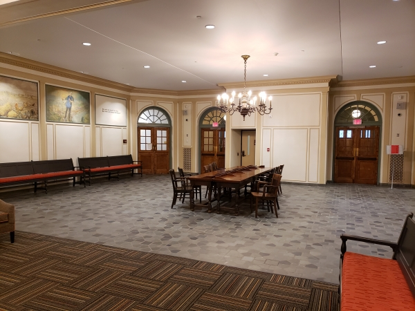 Historical lobby with acoustical and lighting upgrades.