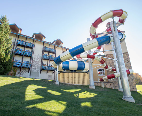 new colorful water slides in front of the existing hotel